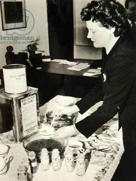 Woman using concentrated preserved food from cans in Post War France, 1950
