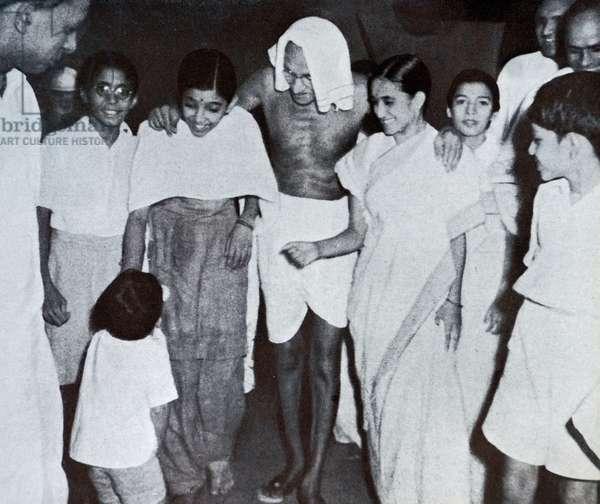 Mohandas Karamchand Gandhi with his grandson Gopu