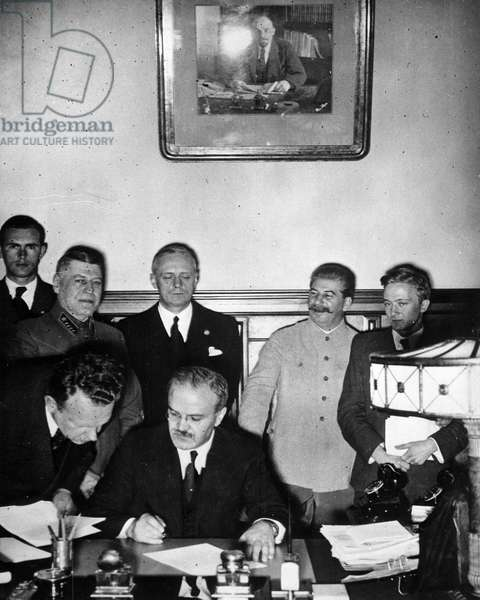 Russian Foreign Minister Vyacheslav Molotov with German Minister Von Ribbentrop and Josef Stalin