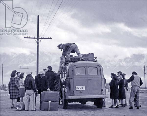 A loading bus leaving Manzanar for relocation, 1943 (b/w photo)