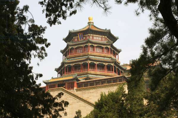 China, Beijing, Summer Palace, Tower of Buddhist Incense, exterior framed by trees