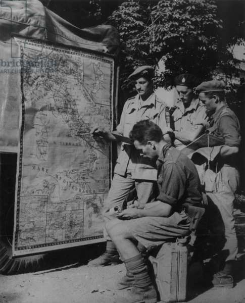 Soldiers Taking Notes While Being Shown a Map, 1942 (b/w photo)