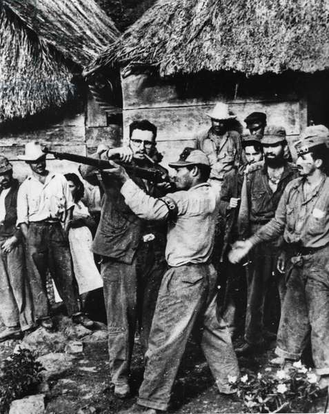 Fidel Castro Giving Rifle Instruction to New Recruits to his Revolutionary Army in Sierra Maestra, a Guerrilla Base in Cuba, Late 1950s.