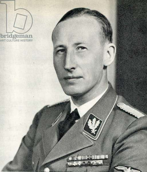 Reinhard Heydrich (1904-1942)  SS-Obergruppenfuhrer, chief of the Reich Security Main Office (including the Gestapo, SD and Nazi police agencies) and Reichsprotektor (State Protector) of Bohemia and Moravia. Heydrich chaired the 1942 Wannsee conference which finalized plans for the extermination of all European Jews in what is now referred to as the Holocaust. Wounded in an assassination attempt in Prague on 27 May 1942 he died from complications arising from his injuries.