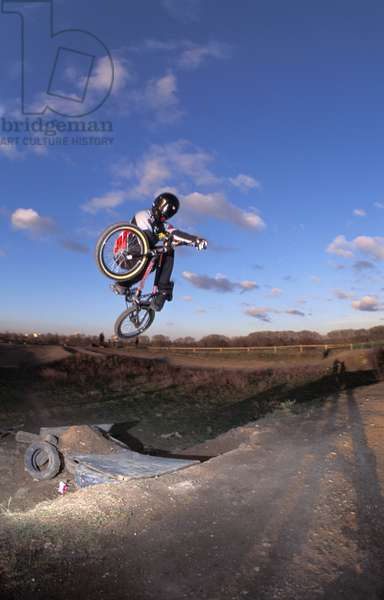 Mountain biker, BMXer, James Hitchcox, in full protection getting some air on the track, UK, 2000's.