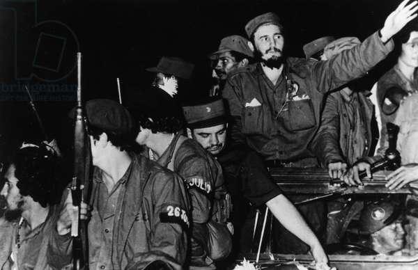Newly Victorious Fidel Castro Ruz Entering Havana at the Head of his Revolutionary Army, Cuba, 1959, Juan Almeida Bosque is Behind him in Profile.