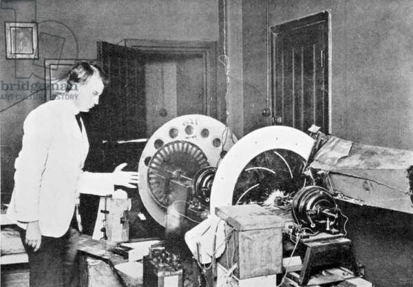 John Logie Baird (1888-1946). Scottish electrical engineer: pioneer of television. Baird with one of his earliest experimental machines.