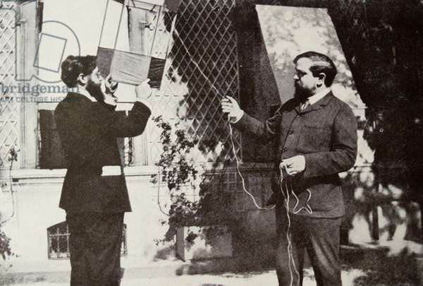 Claude Debussy 1862-1918 - French composer and louis laloy flying a kite.