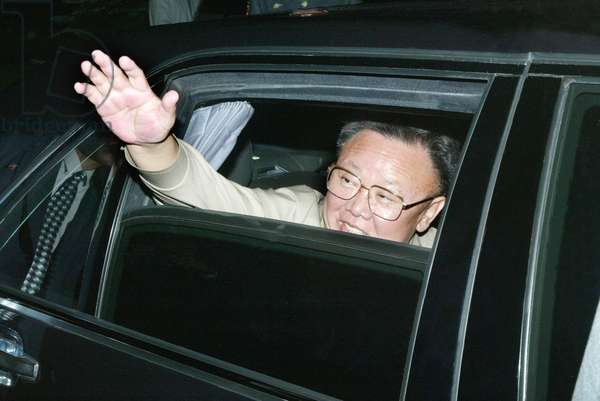 North Korean Leader Kim Jong-Il Waves his Hand Prior to the Departure from Vladivostok, Russia, on Friday, 8/23/02.