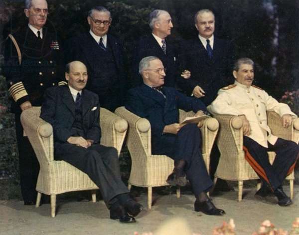 Clement Attlee, Harry Truman, and Joseph Stalin, seated outdoors at Potsdam Conference) 1945