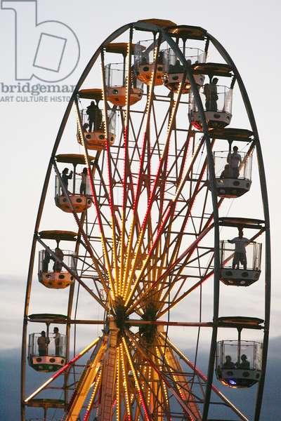 Ferris wheel, at a festival, London UK