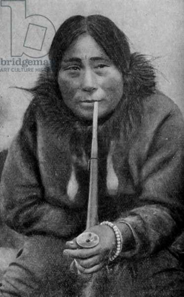 North America. Alaska. Eskimo woman with a pipe.  1920