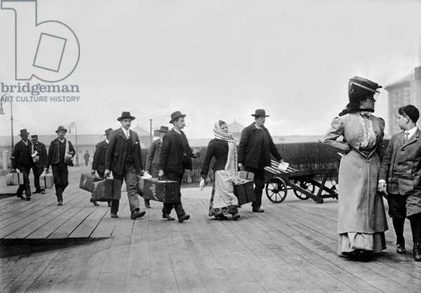 Immigrants Arrive At Ellis, New York, USA, c.1895 (b/w photo)