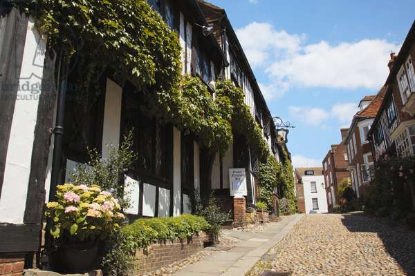 Great Britain, England, East Sussex, Rye, timber framed and brick houses lining steep cobblestone Mermaid Street