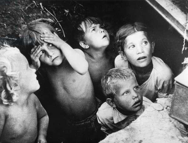 Soviet Children in an Air Raid Shelter During a Nazi Air Raid, World War 2, USSR.