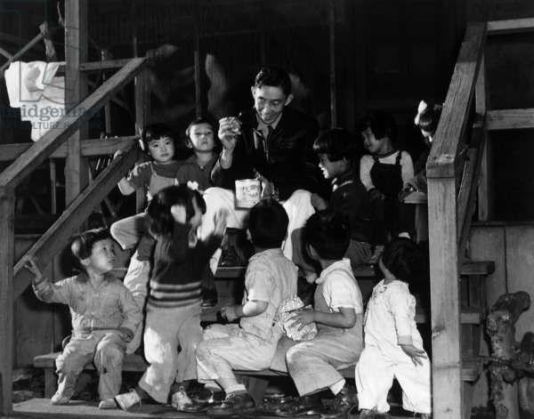 Mr. Matsumoto and group of children, Manzanar Relocation Center, California, 1943 (photo)