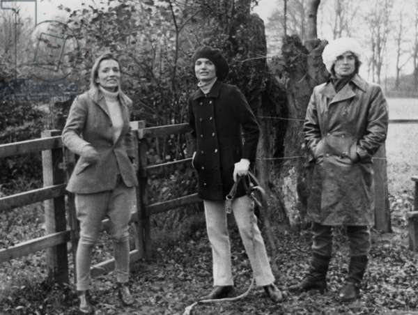 Sunday strollers, dressed against Britain's cold weather, from left, Lee Radziwill, Mrs Jackie Onassis, and dancer Rudolf Nureyev.