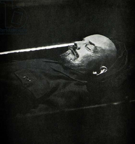 Vladimir Lenin lying embalmed in his coffin