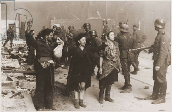 German Nazi SS troops guarding members of the Jewish resistance captured during the suppression of the Warsaw ghetto uprising in 1943. About 13,000 Jews died during the uprising. Most of the remaining 50,000 residents of the ghetto were captured and sent to concentration and extermination camps.