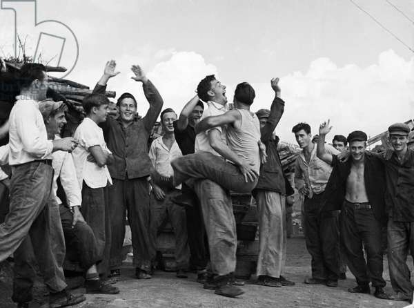 Korean War. American prisoners in a North Korean POW camp celebrating upon hearing news of the armistice. August 1953.