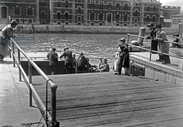 Deportees Leaving Ellis Island (b/w photo)