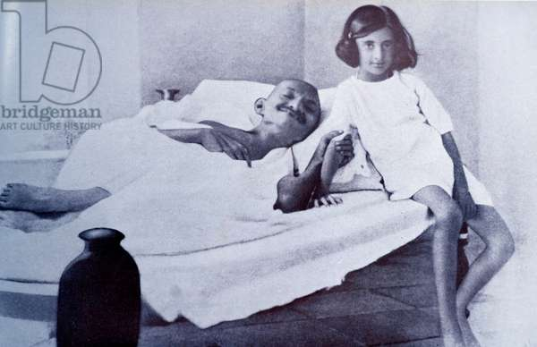 Mahatma Gandhi during a hunger strike is accompanied by Indira (Nehru) Gandhi.