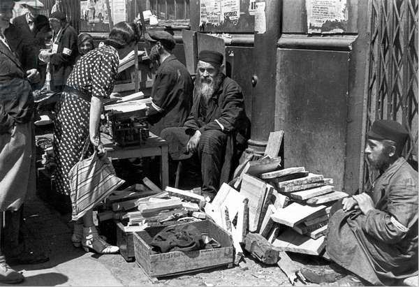Firewood being sold in the Warsaw ghetto by Street Vendors (b/w photo)