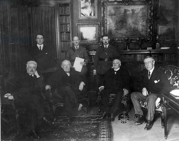 Council of Four at the Versailles Peace Conference 1918. Left to right: Vittorio Emmanuele Orlando, Prime Minister of Italy: David Lloyd George, Prime Minister of Britain: Georges Clemenceau, Prime Minister of France, and (Thomas) Woodrow Wilson, President of the USA. Standing are confidential secretaries.
