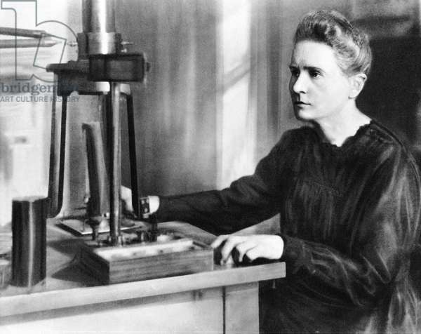 Portrait of Marie Curie in laboratory (b/w photo)