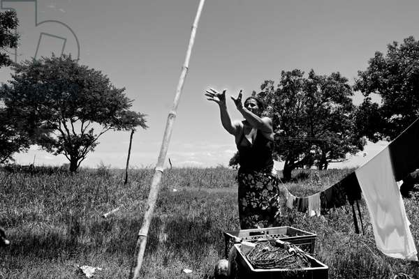 Documentary project, 'The Gulf of the Oblivion' 2005-2007. A documentary project about the poor population that live in the islands of the Gulf of Guayaquil. Local woman hanging out her washing to dry. Ecuador.  (photo)