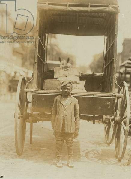 Elwood Palmer Cooper Helper on miller's wagon. 1910 (photo)