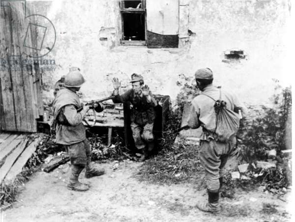 Two Soviet Soldiers Taking a Surrendering German During World War Ll.
