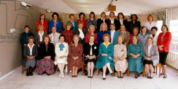 Margaret thatcher heads 31 out of 41 women elected to the British Parliament, in the election of 1987, gather for a historic photograph, in the Spring of 1988.