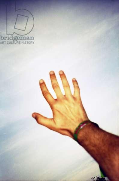 A hand reaching for the sky, Glastonbury Festival, UK 2005.