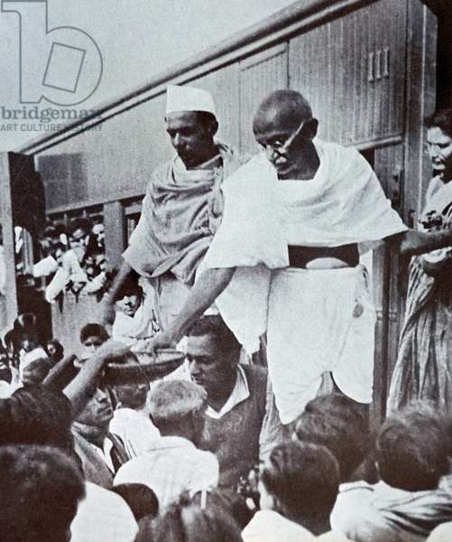 Mohandas Karamchand Gandhi collecting funds for Harijans at a railway station in Bengal