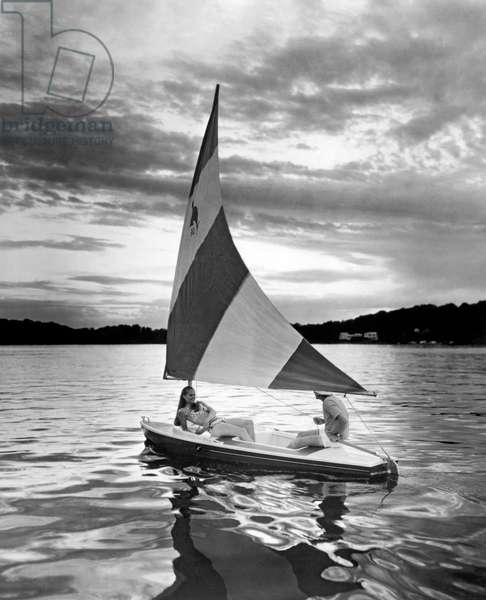 Couple Enjoys At Sunset Sail (b/w photo)