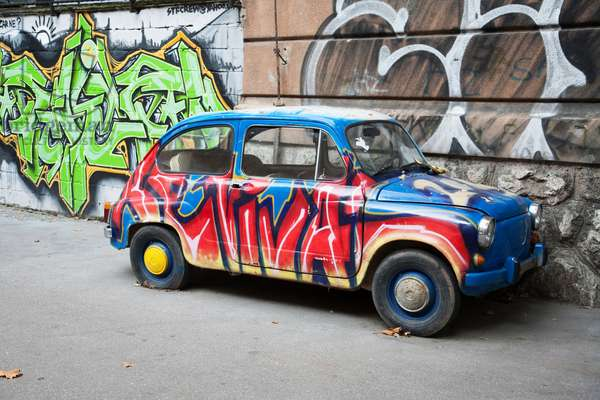 Painted Fiat 600 next to a mural, Sarajevo, Bosnia and Herzegovina (photo)