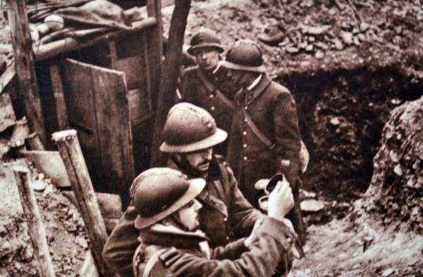 World War Two: French army in trenches guarding the approaches to the Rhine, receiving their daily wine ration 1940