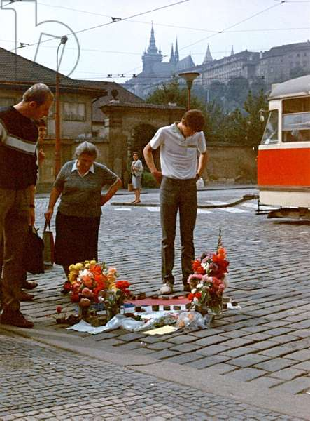Prague Residents Stand By An Improvised Memorial To A Victim Killed By Soviet Soldiers At Klarov Under Prague Castle In August 1968. Czechoslovakia.