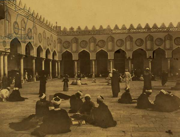 Several groups of theologians, many seated, some writing, in the courtyard of the al-Azhar Mosque. 1880 (photo)
