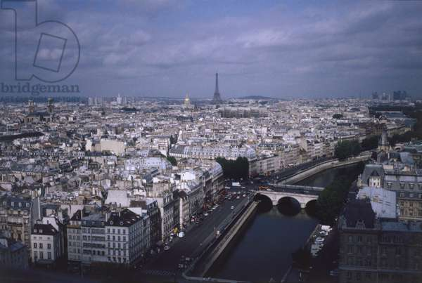 France, Paris, above view of Parisian rooftops the Seine River and the Eiffel Tower in the distance, taken from the Notre Dame Cathedral.