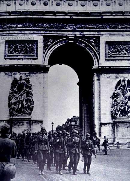 German army marches by the Arc de Triomphe; Paris