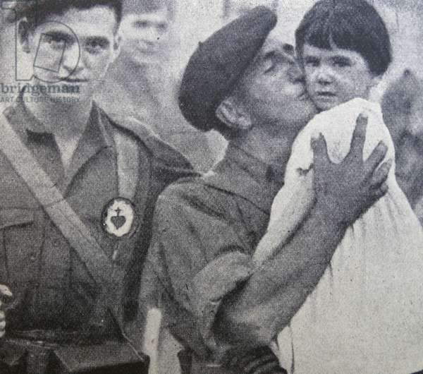 Nationalist volunteer (Carlist) leaves for the front together with his son as they say farewell to a young family member