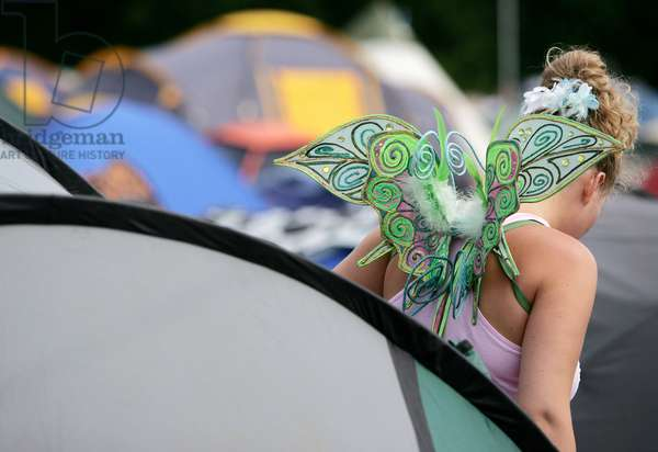 Girl wearing a pair of wings. Isle Of Wight Festival, June 2008.