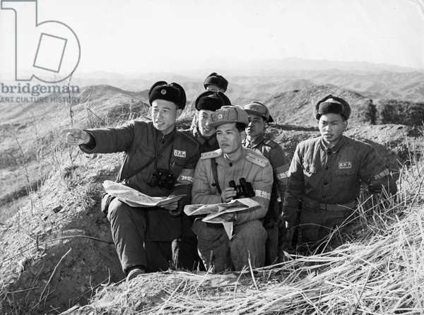 Korean War. Members of the Chinese People's Volunteers guarding Ma Lang San, transfer defense positions to the Korean People's Army. March 1958.