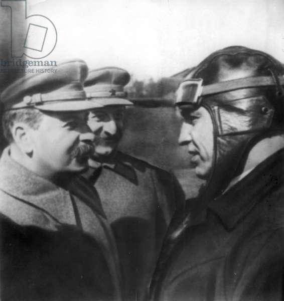 J, V, Stalin and Sergo Ordzhonikidze Talking with Soviet Flyer V, P, Chkalov at Moscow Central Airdrome, May 1935.