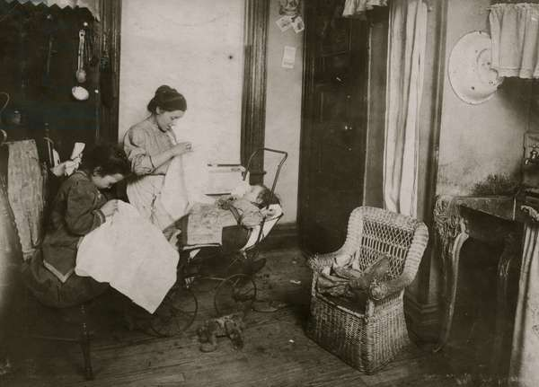 Seven year old daughter, Lorenza, embroidering ladies waists in their dirty kitchen-living room. Lorenza makes the stems of the flowers. 1912 (photo)