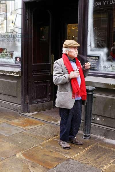 Man outside English pub (photo)