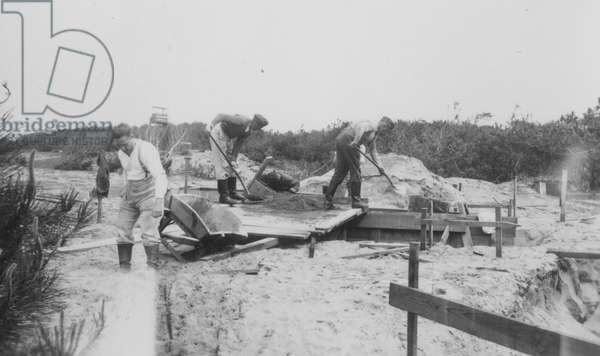 Soldiers Digging on a Beach, 1942 (b/w photo)