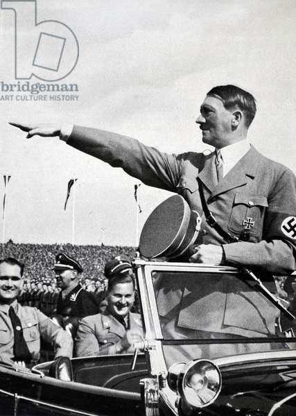Adolf Hitler 1889-1945. German politician and the leader of the Nazi Party, salutes Hitler Youth Rally